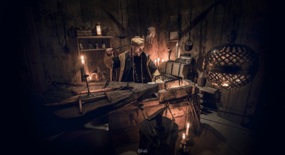 Arkadia kastar en besvärjelse i sitt laboratorium